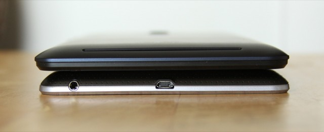 The 2012 Nexus 7 (bottom) keeps its USB port and headphone jack on the bottom of the tablet...