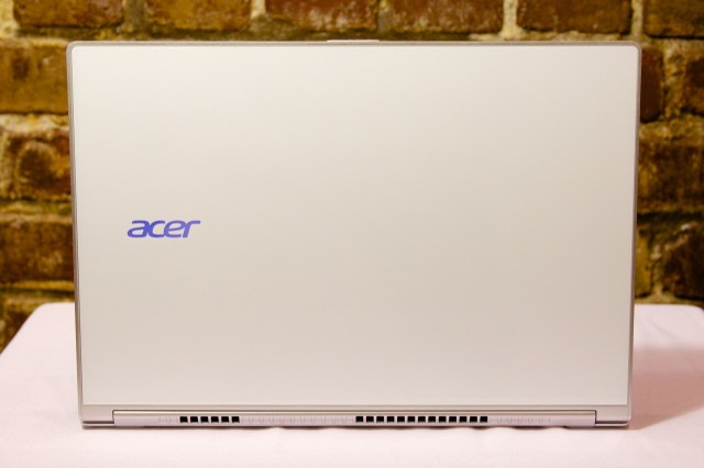 The laptop's white glass lid, emblazoned with a lit-up Acer logo, is fetching but potentially fragile.