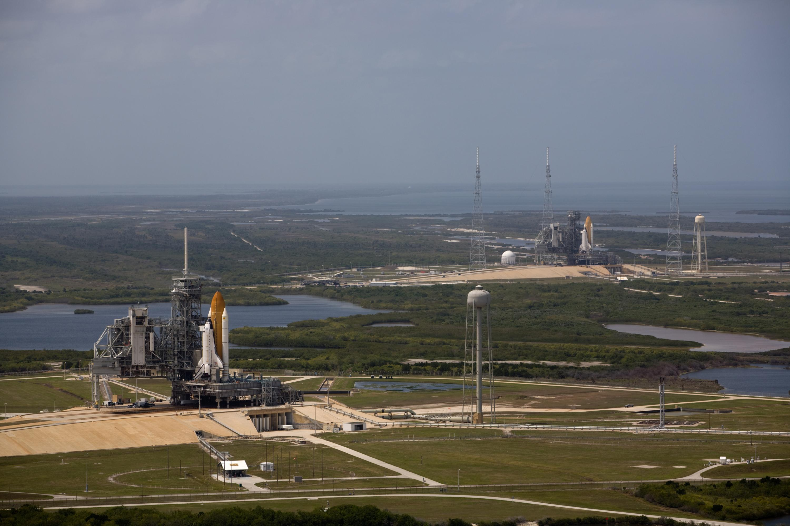 "<em>Atlantis</em> prepares at pad 39A in foreground for her mission to service <a href=""https://en.wikipedia.org/wiki/STS-125"">the Hubble Space Telescope</a>, while <em>Endeavour</em> stands ready to fly a <a href=""https://en.wikipedia.org/wiki/STS-400"">rescue mission</a> if needed from 39B in background. This is the fourth and final time in the shuttle program that two orbiters were simultaneously on the pads at LC39."