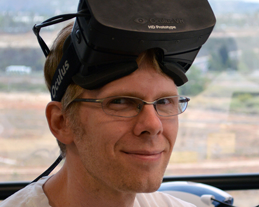 John Carmack, seen here wearing an early prototype Oculus Rift headset.