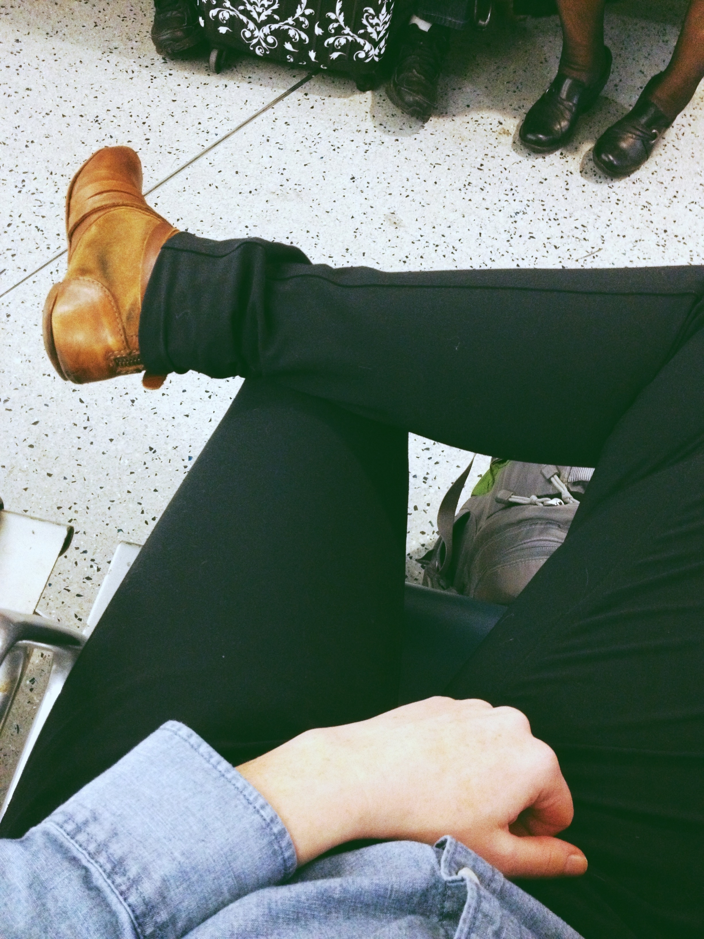A traveling gentlewoman in black Outlier pants.