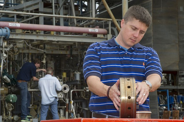 Engineer Greg Barnett at NASA's Marshall Space Flight Center in Huntsville, holding the 3D-printed injector part.