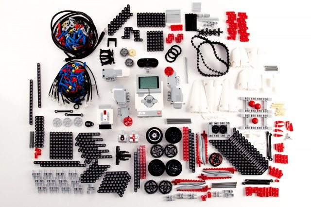 All 594 components of the EV3 set, meticulously arranged on my living room floor. Actually, on a large piece of poster board on my living room floor.
