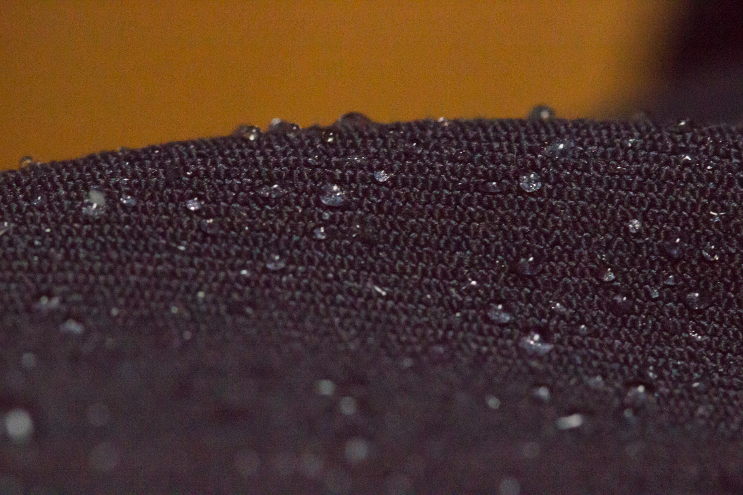 A close-up of the doubleweave twill used in the Ladies' daily riding pants. The Nano Sphere treatment helps keep water, coffee, ketchup, and their ilk from soaking in.