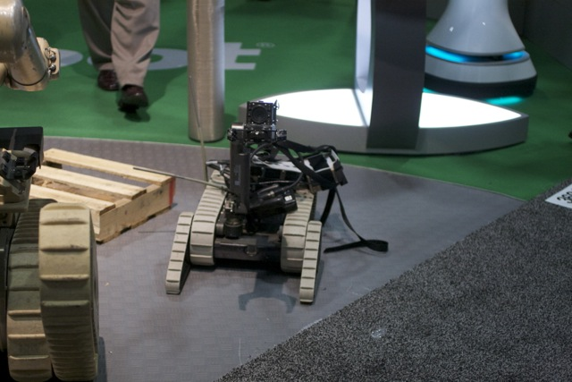 A PackBot, next to its larger sibling the SUGV, at iRobot's booth at August's Unmanned Systems conference in Washington, DC.