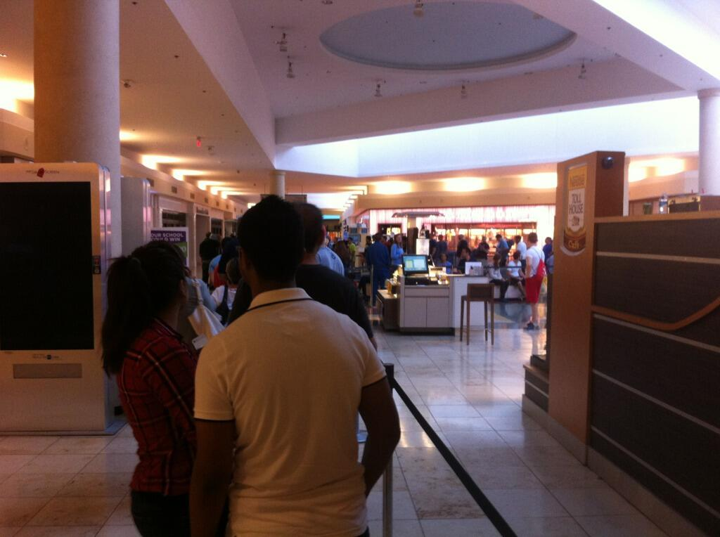 The iPhone 5S line at the Apple Store in Baybrook Mall. Also, the very last picture taken with my trusty old iPhone 4.