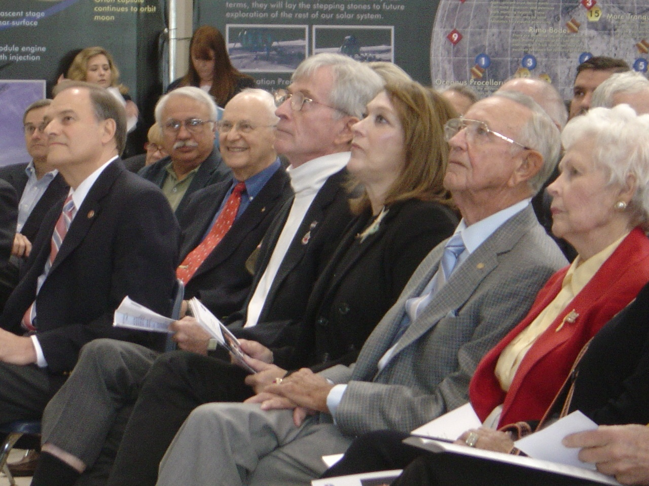 Kraft and his wife at the Saturn V exhibit opening in 2007. Also visible in the image are moon walkers John Young (white turtleneck) and Al Bean (red tie).