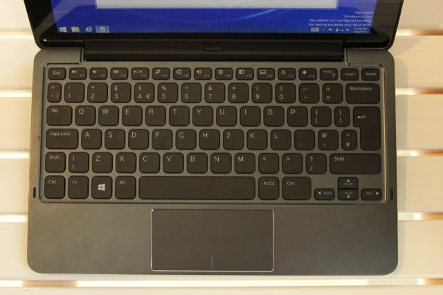 """The """"Mobile Keyboard"""" accessory transforms the tablet into a small laptop. Press the button in the middle of the dock to remove the tablet from the dock."""