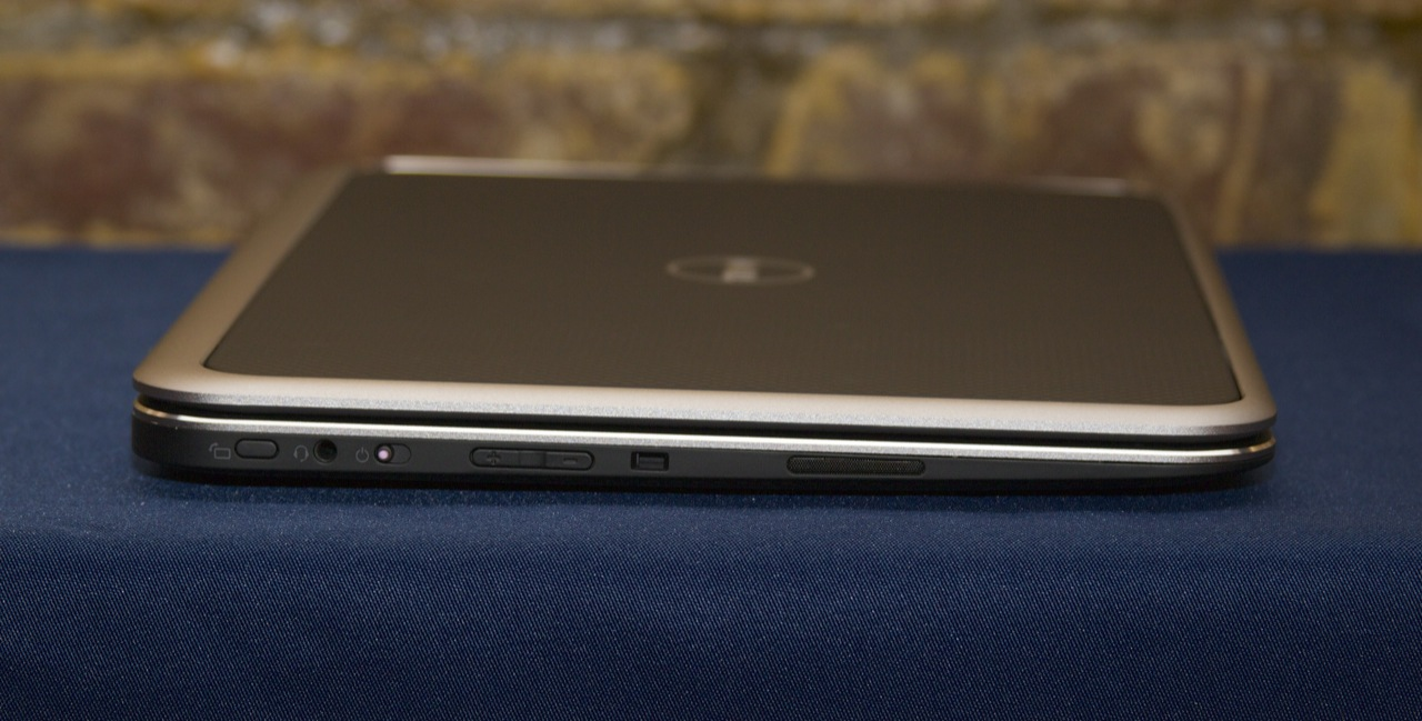 The left edge of the laptop houses a screen orientation lock button, the power slider, and a volume rocker, all of which are convenient when using the device in tablet mode.
