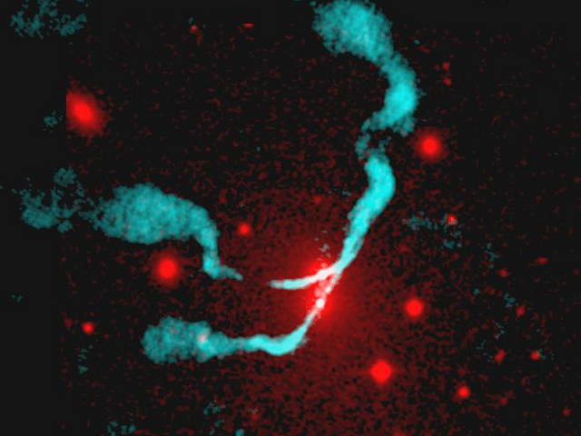 Visible (red) and radio (blue) image of the binary black hole in the galaxy 3C75. The black holes themselves are the two bright dots in the radio emission, which are the sources of the streaming jets.