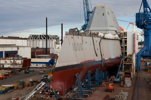 The USS Zumwalt getting a coat of paint at Bath Iron Works. The ship is exotic in many ways, but it runs on off-the-shelf computing technology. It  besides costs nearly $4 billion.