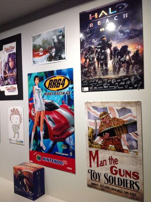 Posters and boxes on the wall highlight just some of the games worked on by Digipen alumni.