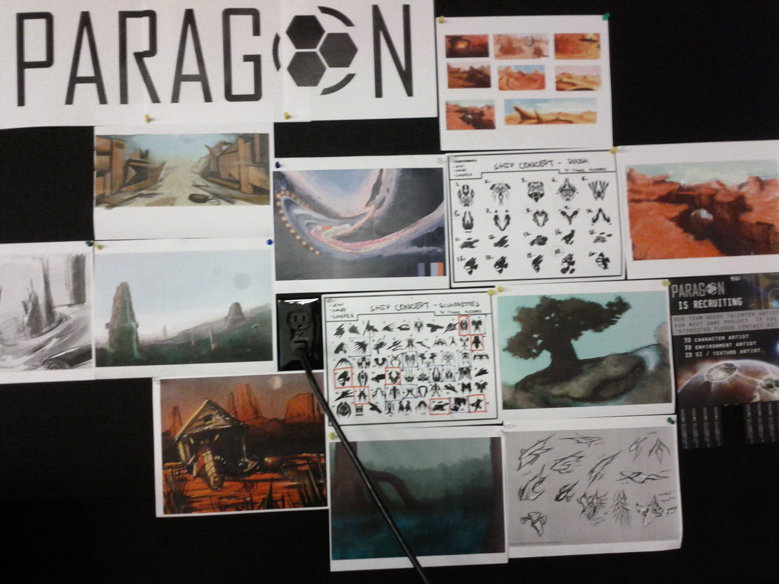 "Concept art hangs on the wall to attract students to join ""Team Paragon."""