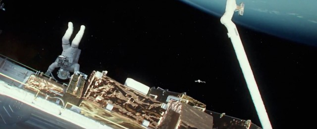 Screencap from the Gravity trailer, showing the start of a giant debris storm. Note the monstrous size of the piece of debris near frame center.