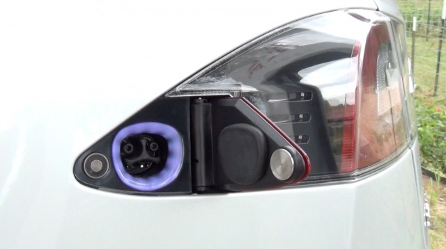 The Model S charging port is concealed beneath one of the taillights.
