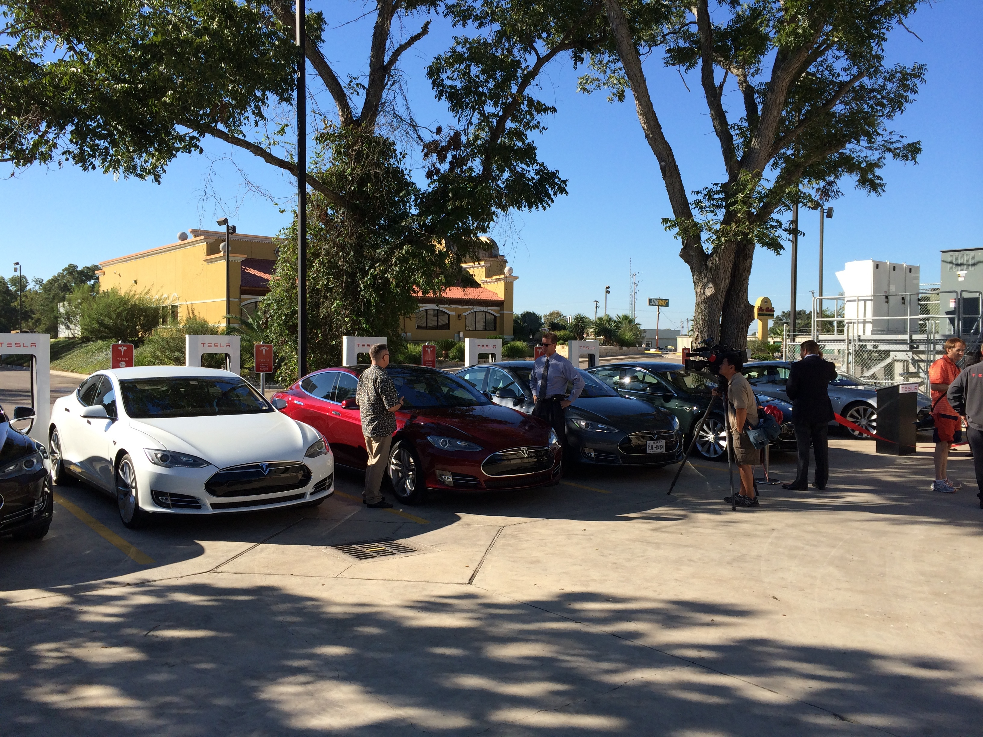 The Columbus Supercharger opening was attended by dozens of Houston Tesla owners—folks who are buying cars in spite of the legislative roadblocks that lobby groups are keeping propped up.