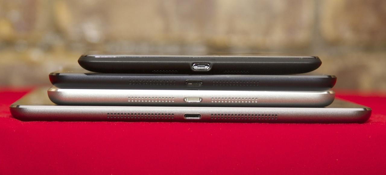 From bottom to top: the iPad Air, the Retina iPad mini, the standard iPad mini, and the 2013 Nexus 7. All very thin tablets.