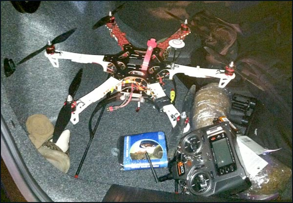 The hexacopter drone and contraband discovered in the suspects' vehicle.