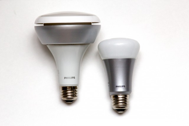 The new Hue BR30 downlight at left, next to a regular Hue A19 bulb at right.