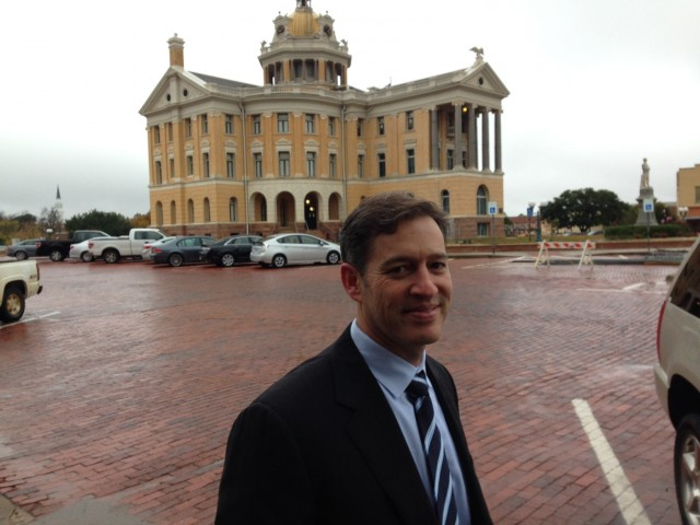 TQP attorney Marc Fenster stands in front of the historic county courthouse in Marshall, TX.