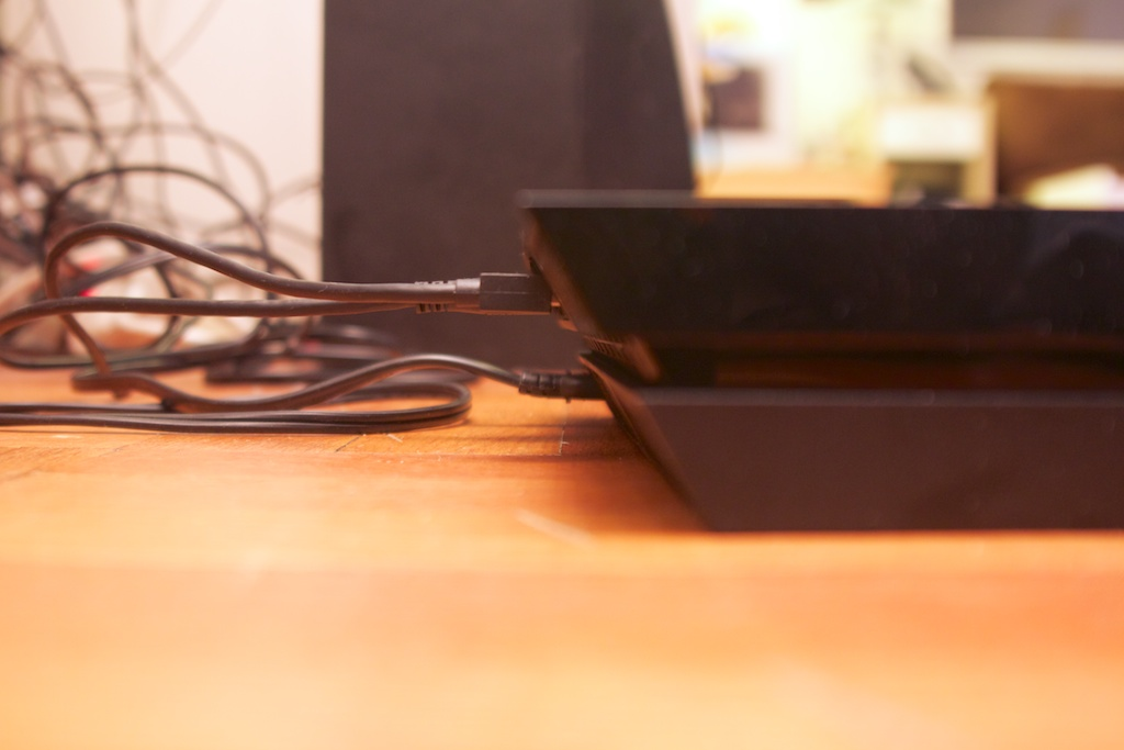 The back top edge makes it a little tough to plug in the few plugs the PS4 needs.