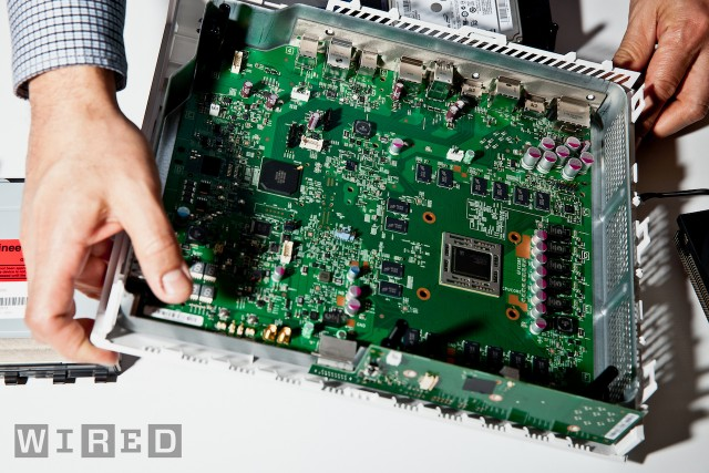 Inside the Xbox One. The large chip near the center surrounded by the RAM chips is the main processor, which combines the CPU and GPU among other things.
