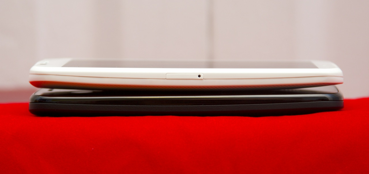 Perhaps due to the removable cover, the Moto G (bottom) is a little thicker and heavier than the Moto X.