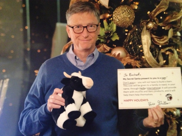 Bill Gates holding his representative tokens of a charity donation made on a redditor's behalf.