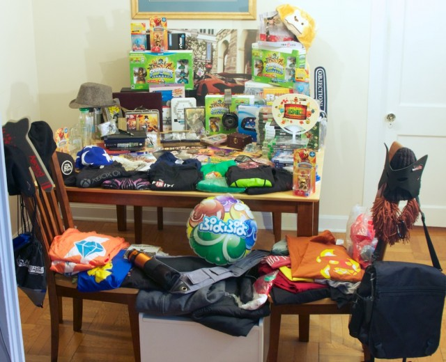 This table-worth of swag turned into $23,000 of charity donations.