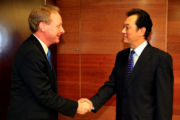 Microsoft's General Counsel Brad Smith meeting with Chinese vice minister of commerce Wang Chao earlier this month. Microsoft is seeking to assure customers like China that it's not handing NSA backdoors to their networks.
