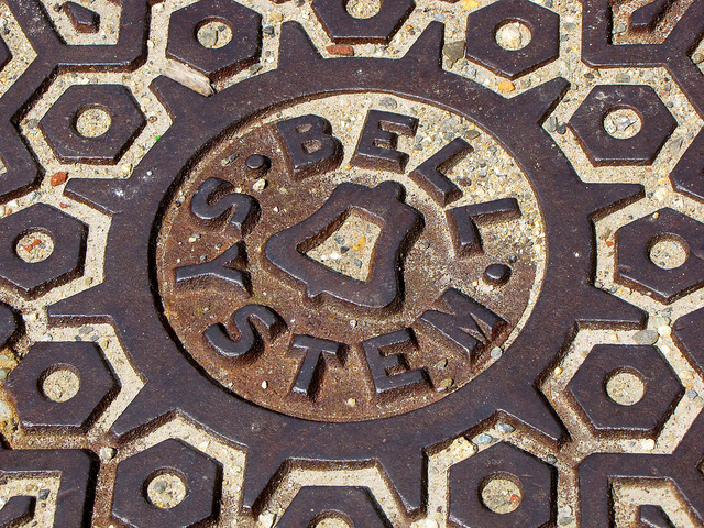 """Bell System"" manhole cover along Main Street in Durham, New Hampshire."