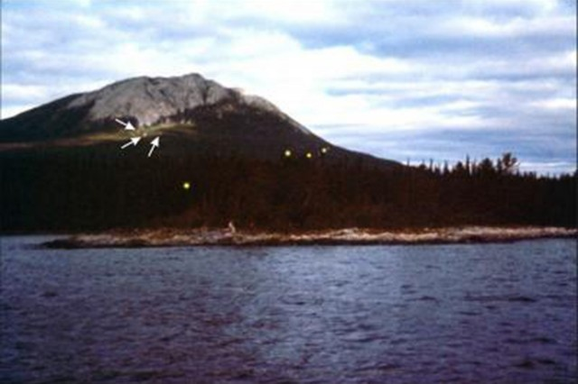 Earthquake lights from Tagish Lake, Yukon-Alaska border region, around 1 July, probably 1972 or 1973 (exact date unknown). Estimated size: 1m diameter. Closest orbs slowly drifted up the mountain to join the more distant ones.
