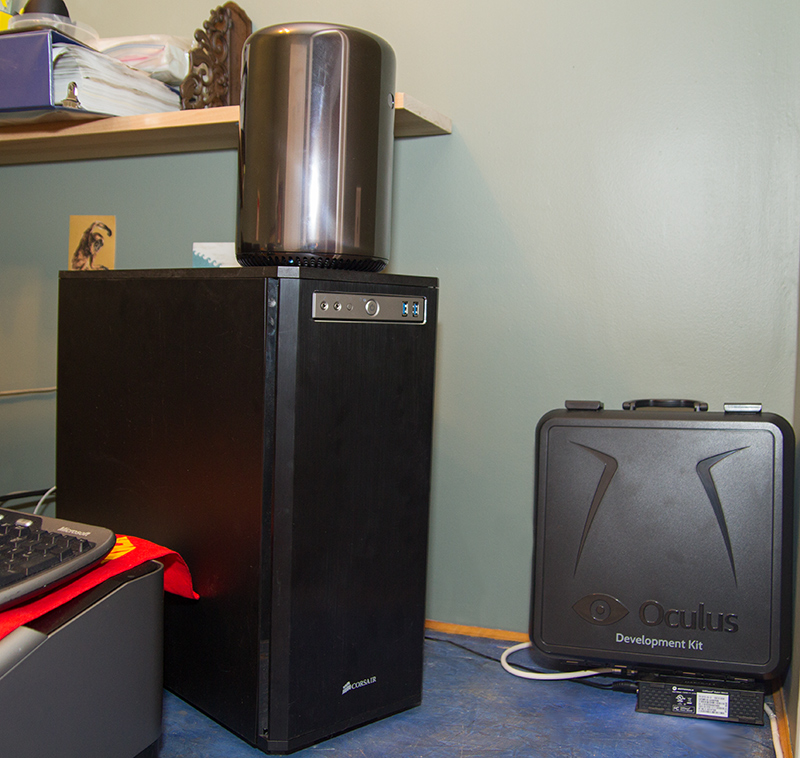 <br /> My Linux machine next to the 2013 Mac Pro. My 550D's truly epic amount of empty drive bays (and nasty wire layout) is advertising enough for the new Mac Pro's design philosophy: only take up space that you actually need to.