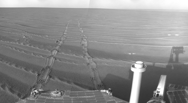 A partial self-portrait, showing the shadow of the now-iconic dual cameras that sit atop Curiosity's mast.