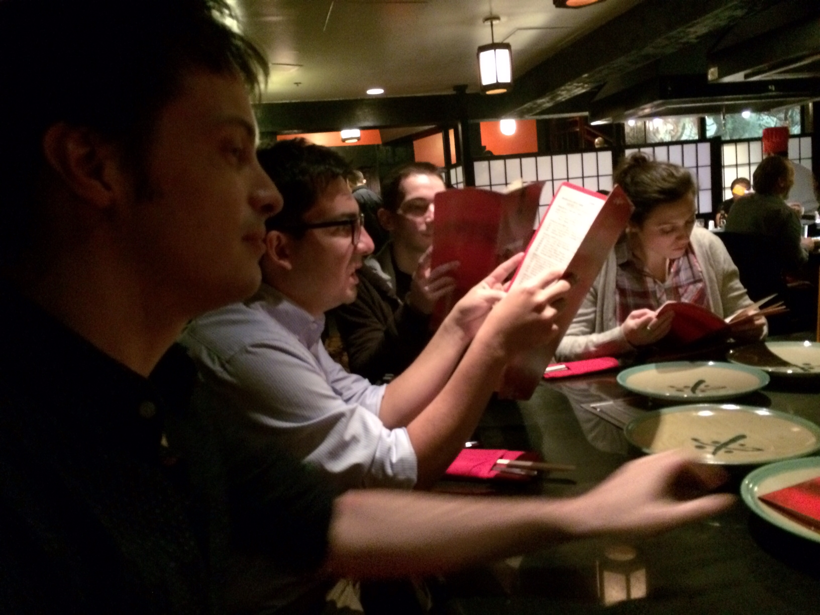 A cell phone camera pic of most of the Ars CES crew at Benihana, preparing to get our drink on and see the onion-stack volcano.