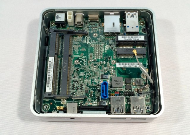 You can see the SATA data and power connectors on the regular NUC's system board—the black power connector is at the bottom in this picture, parallel to the case, and the blue data connector is just above it. The new NUC actually leaves you space to do something with them.