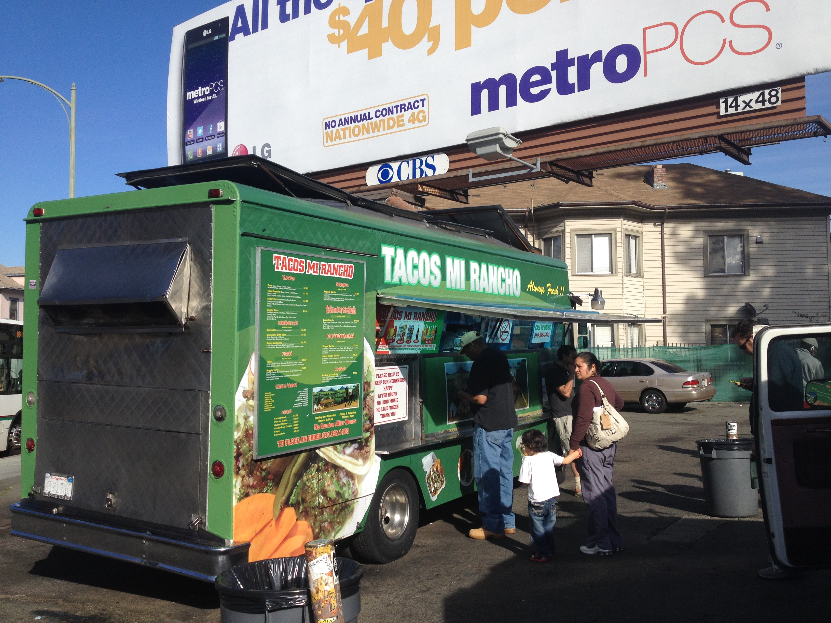 This taco truck sits within about 20 feet of an Arisebitcoin billboard in Oakland at the intersection of International Boulevard and 1st Avenue.