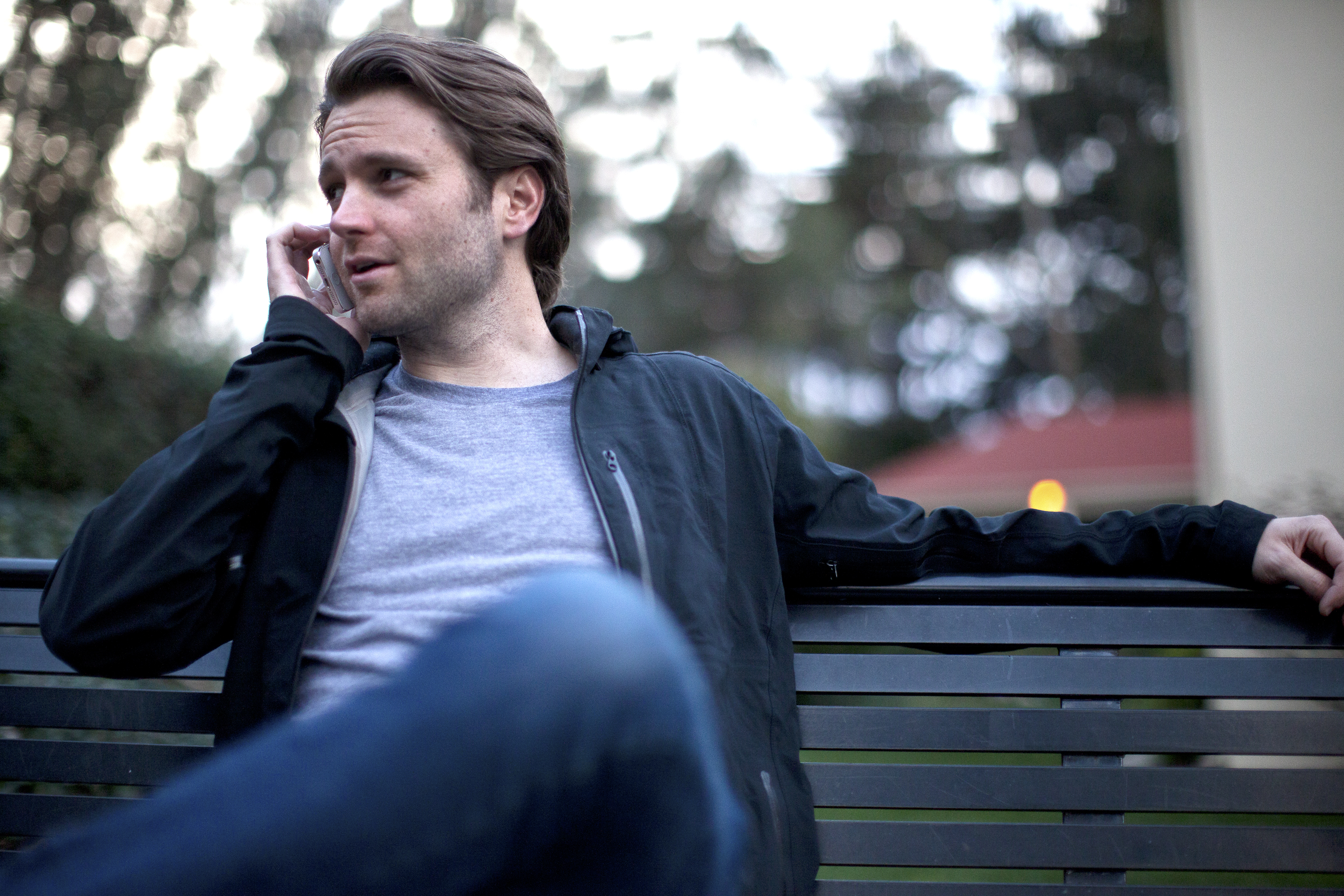 Kyle Kirchhoff, CEO of Leap Transit, sitting on a bench in the Presidio, San Francisco.