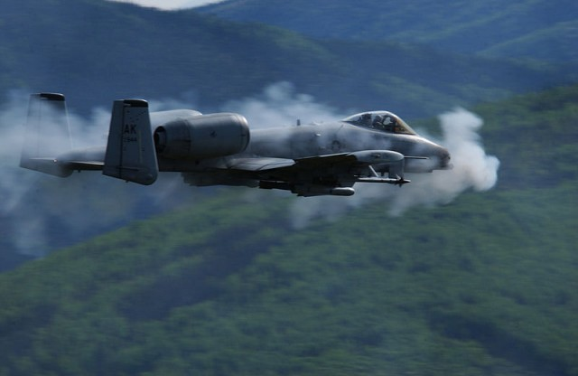 A US Air Force A/OA-10 Thunderbolt II surrounded by a cloud of gun smoke. The Air Force wants to send the A-10 to boot hill to keep funding for the wounded F-35 intact.