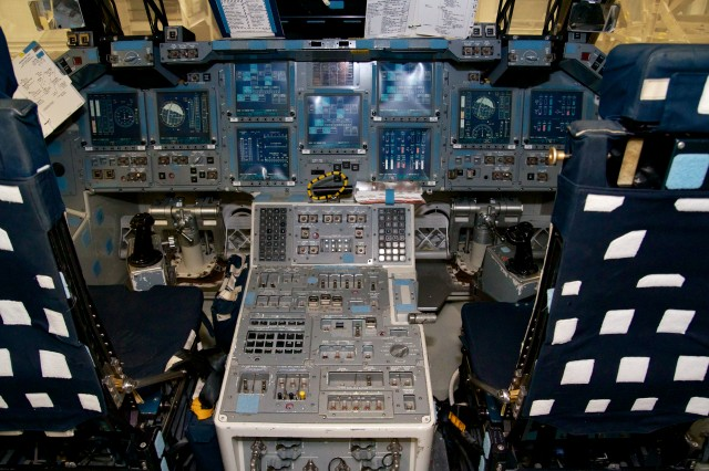 Space shuttle cockpit mockup from the CCT-2 (Crew Compartment Trainer) at NASA's Space Vehicle Mockup Facility. The middle console contains most of the attitude and translation controls <em>Atlantis'</em> commander and pilot would have used to fly the rendezvous with <em>Columbia</em>.