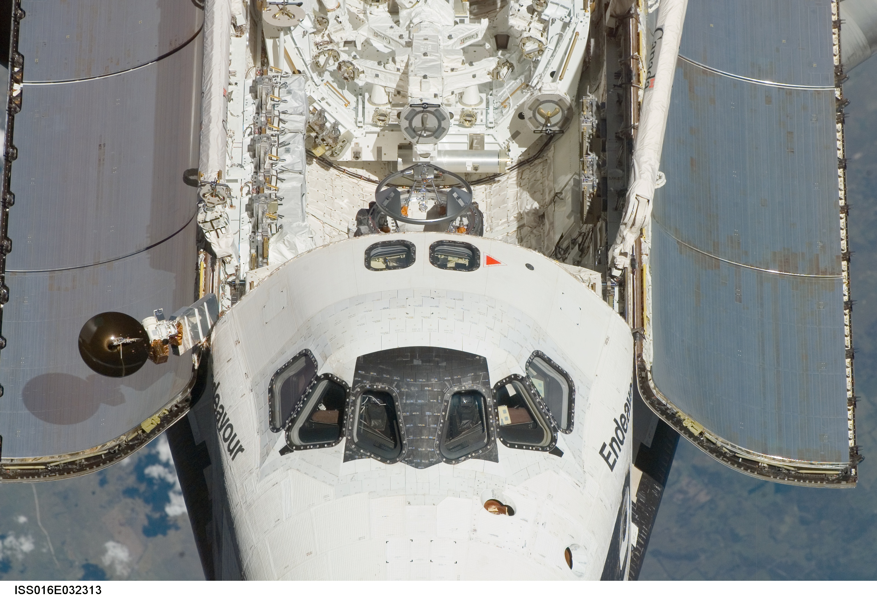 <em>Endeavour</em> on approach to the ISS, showing details of forward flight deck windows, upper flight deck rendezvous windows, and airlock docking assembly aft of the flight deck.