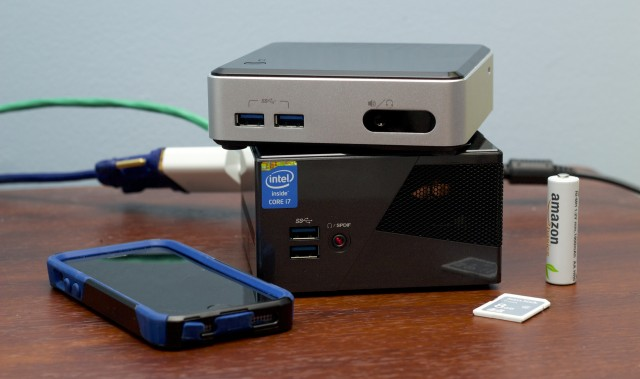 Intel's Haswell NUC sitting on top of Gigabyte's larger (but more powerful) Brix. Intel sees mini-PCs as one of the rare PC markets where growth is possible.