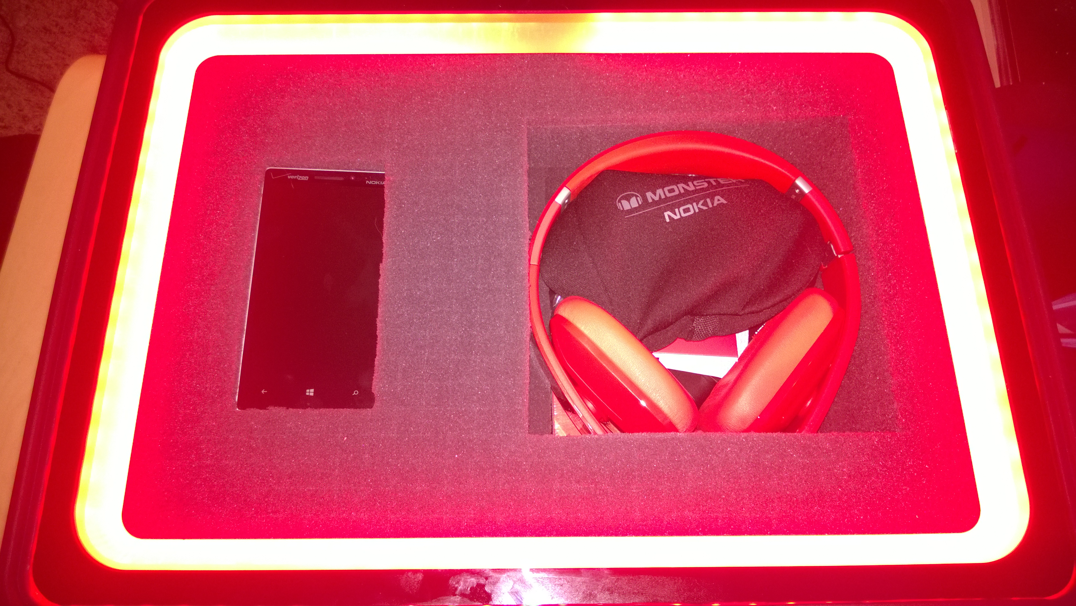 All is revealed: the phone on the left and the headphones on the right.