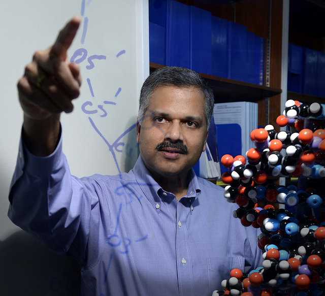 IBM's Ajay Royyuru points to a drawing of the chemical formula for DNA at IBM Research headquarters in Yorktown Heights, New York.