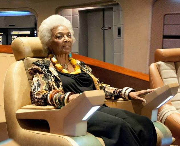 Nichelle Nichols, who portrayed Lt. Uhura on TOS, posed at a 2013 convention in the captain's chair.