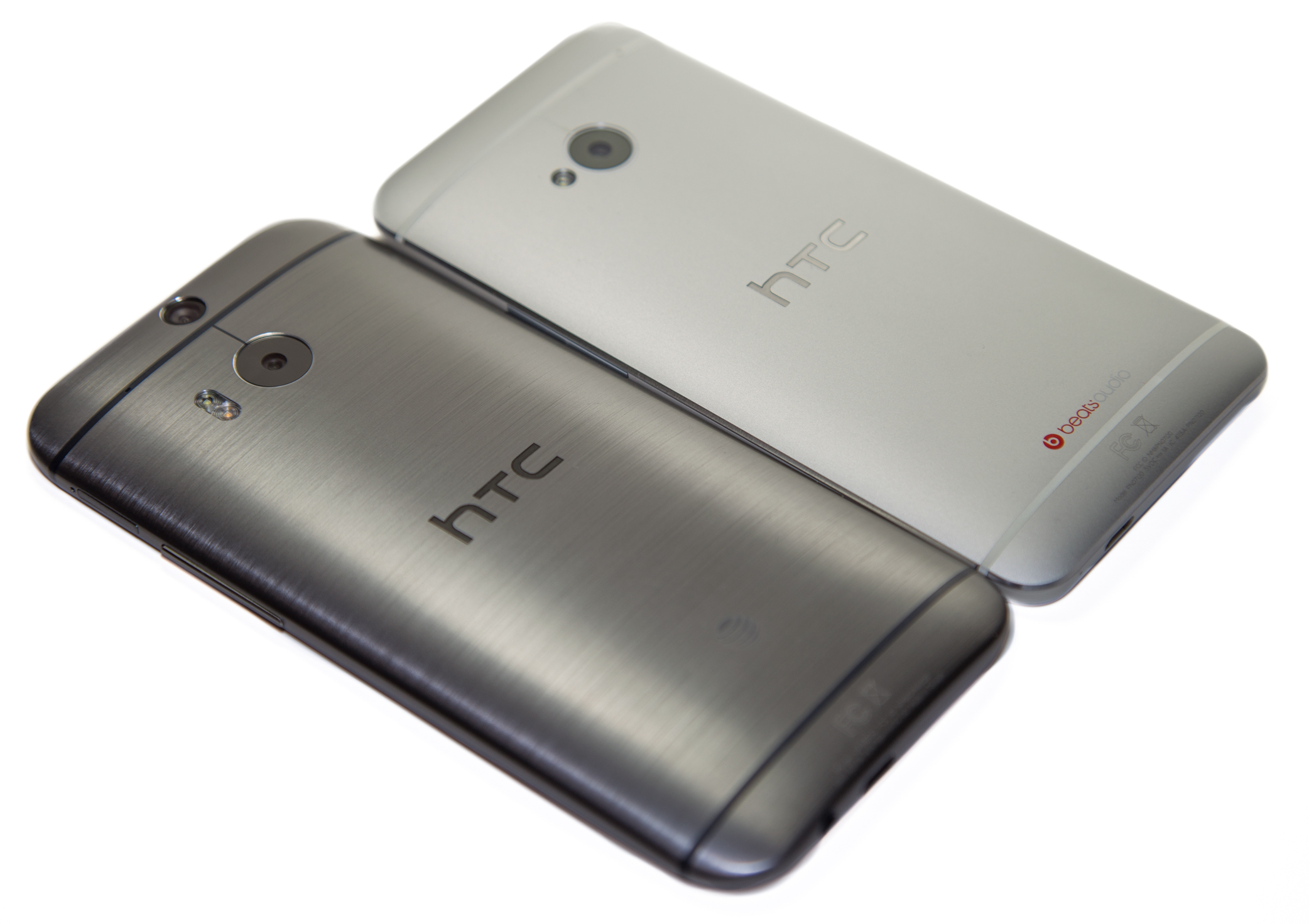 The HTC One M8 (bottom left) versus the HTC One M7 (top right).