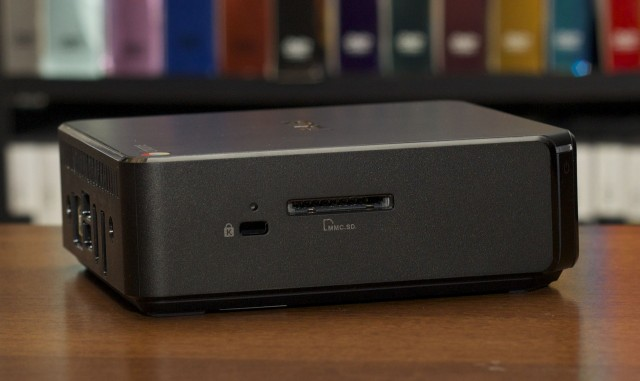The pinhole above the lock slot and to the left of the SD card slot is used to put the Chromebox in developer mode.