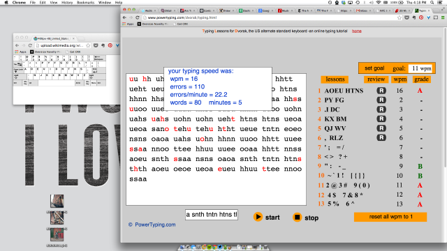 My first typing lesson. Things only go down from here. The window to the left is the keyboard map I use for reference.