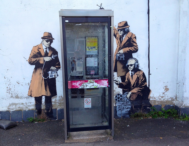 A recent Banksy-style street art mural that appeared in Cheltenham, England, near the GCHQ office building.