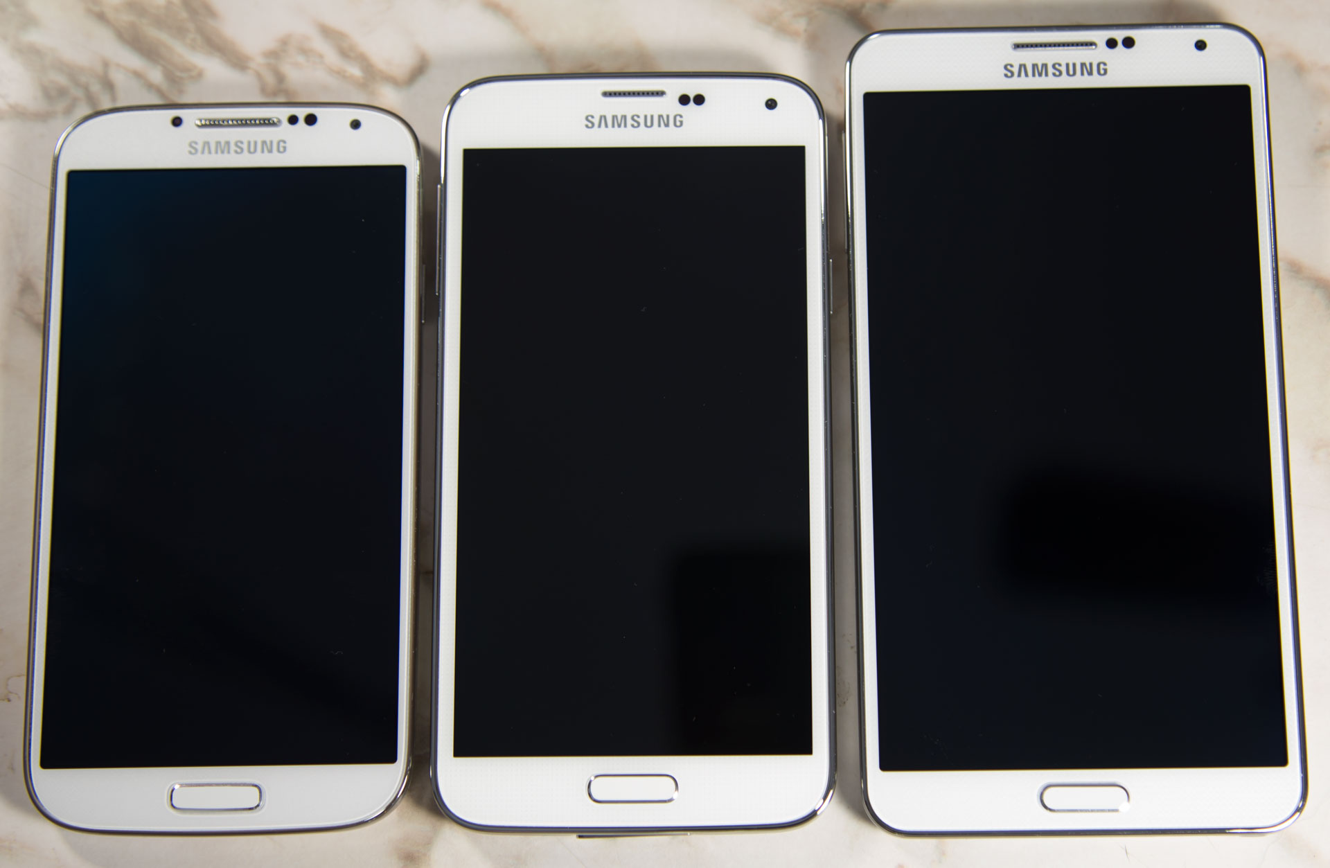 Before reading on, which piece of hardware looks the most modern? Which looks the oldest? The lineup is Galaxy S4, S5, and Note 3.